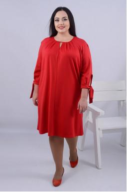 Стильна однотонна сукня міді батал